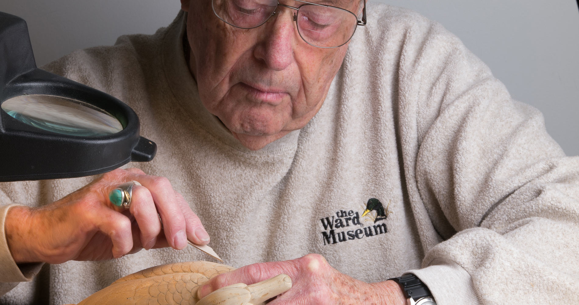 A carver at the Ward Museum - image courtesy Dave Harp / Bay Journal